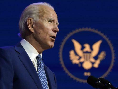 President-elect Joe Biden speaks at The Queen theatre, Monday, Nov. 9, 2020, in Wilmington, Delaware (Carolyn Kaster/AP)