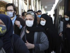People wear protective face masks to help prevent the spread of coronavirus in Tehran, Iran (AP/Ebrahim Noroozi, File)