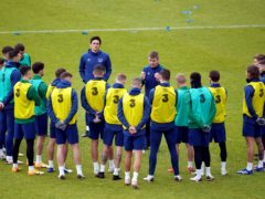 Republic of Ireland manager Stephen Kenny, centre right, speaks to the players during training (John Walton/PA)