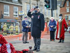 Wreaths are laid at the war memorial in Royal Wootton Bassett (Ben Birchall/PA)