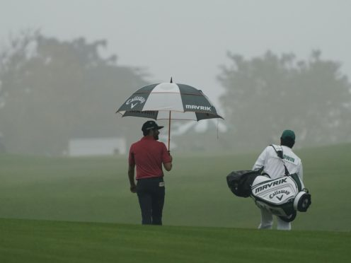 Adam Hadwin walks back to the clubhouse after play was suspended (Charlie Riedel/AP)