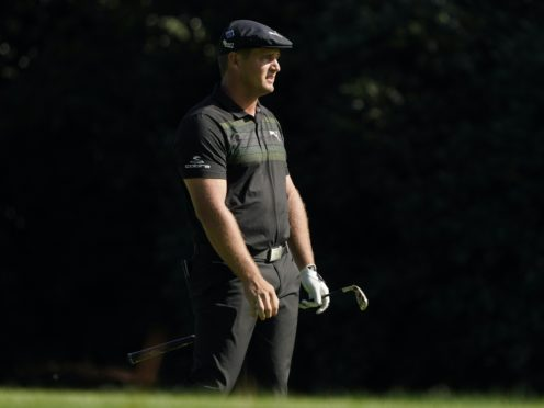 Bryson DeChambeau watches his shot on the 10th fairway during the first round of the Masters (AP Photo/Charlie Riedel)