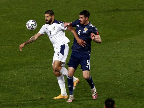 Declan Gallagher, right, shackled Serbia's Aleksandar Mitrovic but suffered his first Scotland loss in Israel (Novak Djurovic/PA)