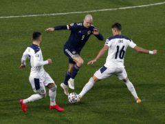 Lyndon Dykes, centre, bullied the Serbia defence (Novak Djurovic/PA)