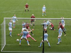 Manchester United's Kirsty Hanson levels against Manchester City. (Martin Rickett/PA)