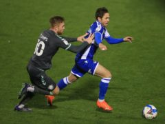 Callum Camps (left) and Bristol Rovers' Sam Nicholson battle for the ball (Mike Egerton/PA)