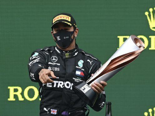 Lewis Hamilton celebrates winning the Turkish GP and his seventh world title (Ozan Kose/AP)