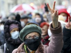 A woman gestures as she attends a pensioners' opposition rally in Minsk (AP)
