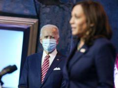 President-elect Joe Biden listens to Vice President-elect Kamala Harris (Andrew Harnik/AP)