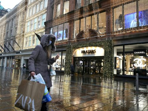 Non-essential shops will have to close in 11 council areas of the country from Friday (Andrew Milligan/PA)
