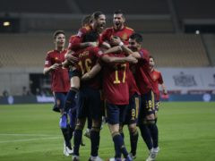 Spain's players celebrated a memorable win over Germany (Miguel Morenatti/AP)