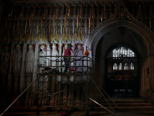 Conservation workers using museum grade vacuums and brushes begin the task of cleaning years of dirt and dust from the Pulpitum, known as the King's Screen, at York Minster (Danny Lawson/PA)