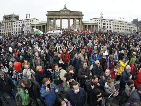 Protests have been growing in Germany in recent weeks (AP Photo/Michael Sohn)