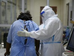 A medical worker attends to a coronavirus patient in a Nairobi hospital (Brian Inganga/AP)