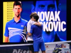 Novak Djokovic (right) embraces Alexander Zverev after his victory at The O2 (John Walton/PA)