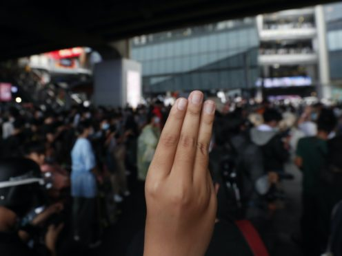 The three-finger protest gesture is flashed during a student rally in Bangkok (Sakchai Lalit/AP)