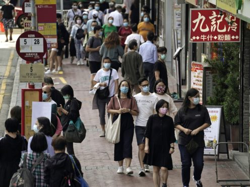 People wearing masks in Hong Kong (AP/Kin Cheung, File)