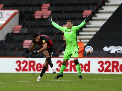 Dominic Solanke scores his second after dispossessing Reading's goalkeeper (Kieran Cleeves/PA)
