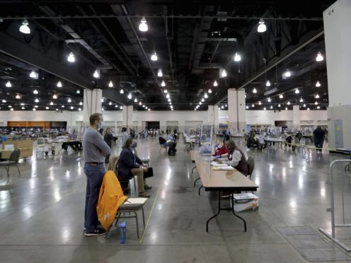 Election workers recount ballots at the presidential election recount (Mike De Sisti/Milwaukee Journal-Sentinel via AP)