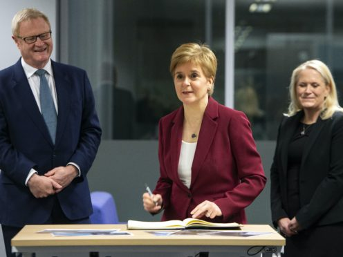 Nicola Sturgeon flanked by Scottish National Investment Bank chief executive Eilidh Mactaggart and chair Willie Watt (Andy Buchanan/PA)