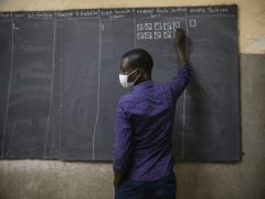 An election official counts the ballots in at a polling station in Ouagadougou, Burkina Faso (Sophie Garcia/AP)