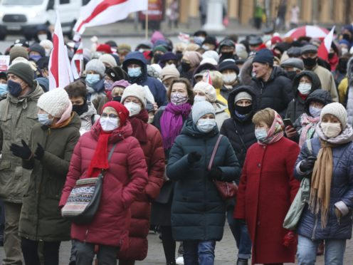 Belarus pensioners wearing face masks to protect against coronavirus attend an opposition rally (AP)