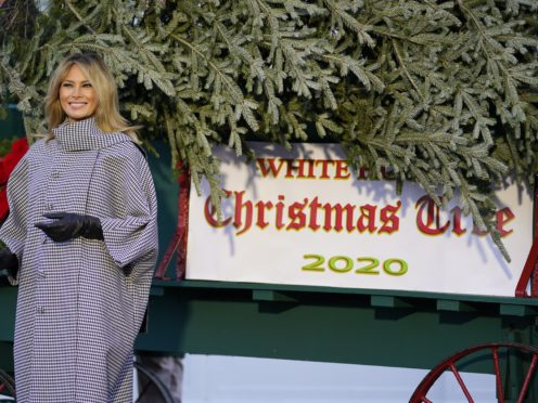 Melania Trump stands next to the 2020 official White House Christmas tree (Andrew Harnik/AP)