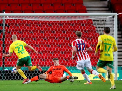 Norwich striker Teemu Pukki, left, nets his second of the game in the win at Stoke (Nick Potts/PA)