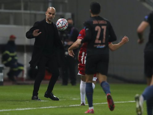 Pep Guardiola was satisfied with Manchester City's performance after Champions League progression was secured in Greece (AP Photo/Thanassis Stavrakis)