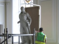 Contractors board up a statue of slave trader Sir Thomas Picton at Cardiff's civic building following a vote to have it removed (Cardiff Council/PA)