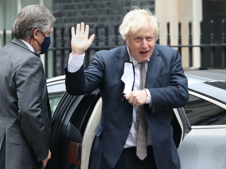 Prime Minister Boris Johnson arrives back at 10 Downing Street, London on his first day out of self-isolation after he came into contact with an MP who later tested positive for coronavirus (Yui Mok/PA)