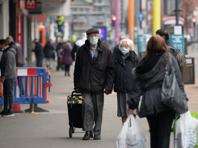 Shoppers in Leicester during the final week of the second national lockdown (Joe Giddens/PA)