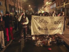 """Demonstrators march with a banner reading 'Vote for Macron they said"""", during a rally against police brutality on the Place de La Republique in Paris (Michel Euler/AP)"""