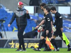 Liverpool manager Jurgen Klopp (left) gestures towards the match officials after the Premier League match at the AMEX Stadium, Brighton.