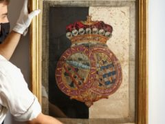 A silk hatchment from Nelson's funeral carriage is expected to fetch £50,000 at auction (Tristan Fewings/Getty Images for Sotheby's/PA)