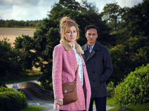 Charlotte Bellamy as Laurel Thomas and Chris Bisson as Jai Sharma in Emmerdale (ITV/PA)