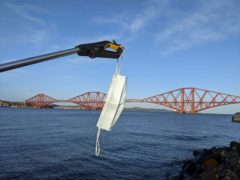 A mask was found discarded on a beach close to the Forth Rail Bridge (Catherine Gemmell/PA)