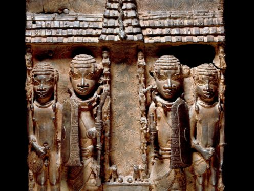 Benin brass plaque showing Benin court officials flanking a palace entrance or altar (Trustees of the British Museum)