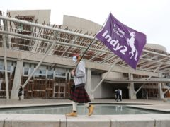 Scots believe a pro-independence majority in Holyrood would constitute a mandate for another referendum by a margin of almost two to one, according to a new poll (Andrew Milligan/PA)