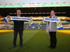 Son in law David Wilkinson and granddaughter Emma Wilkinson in front of the Jack Charlton stand (Leeds United handout)