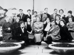 The cast of Coronation Street in the Granada TV Centre car park in Manchester, between rehearsals for the first programme broadcast on December 9 1960 (PA)