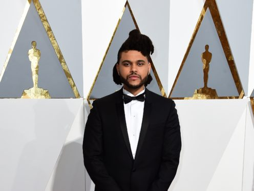Apple Music has revealed its most popular songs streamed in the UK this year, with The Weeknd making the top five (Ian West/PA)