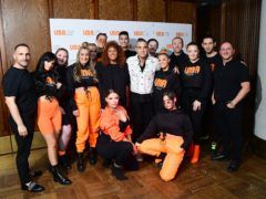 Robbie Williams with the LMA Choir (Ian West/PA)