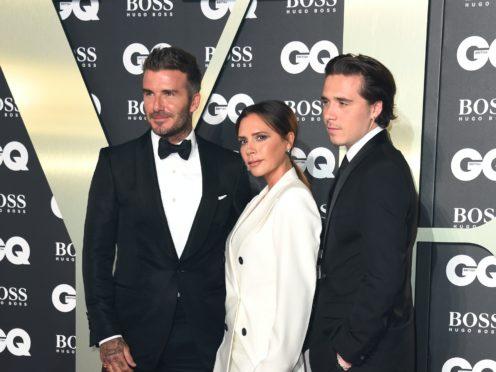 David, Victoria and Brooklyn Beckham (Matt Crossick/PA)