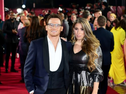 TV presenter Stacey Solomon has announced she and actor partner Joe Swash are engaged (Ian West/PA)
