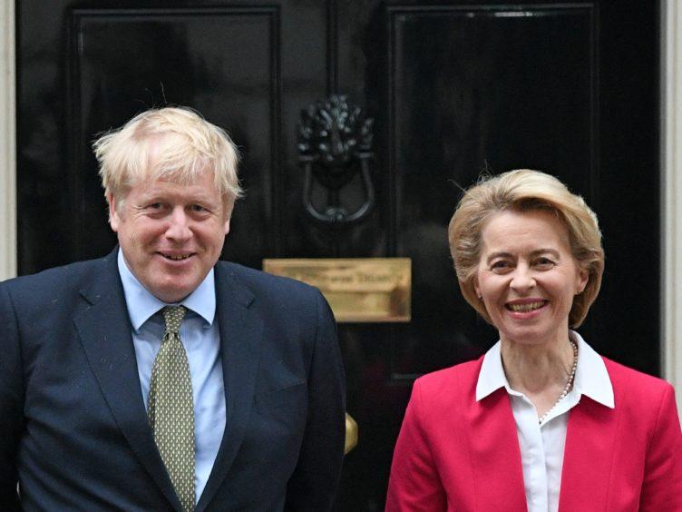Prime Minister Boris Johnson greets EU Commission president Ursula von der Leyen (Stefan Rousseau/PA)