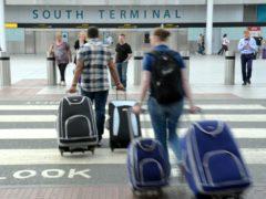 Passengers at Gatwick airport, London (Anthony Devlin/PA)