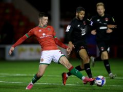 Rory Holden, left, will be absent for Walsall's clash with Carlisle (Nick Potts/PA)