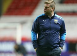 Karl Robinson will be without Rob Atkinson (PA)
