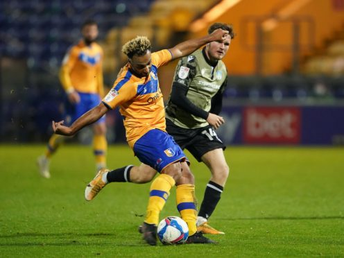 Nicky Maynard (left) looks set to miss Mansfield's League Two clash with Salford due to a hamstring problem (Zac Goodwin/PA Images).